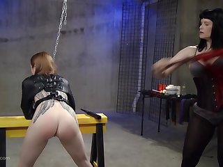 Kinky lesbian fetish slave gets her pussy penetrated with toys