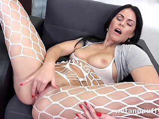 Beautiful chick fingers her twat and licks them clean