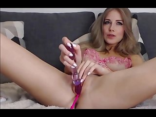 hot russian babe enjoys her dildo deep inside her pussy