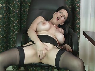 Busty brunette amateur Stacy Ray takes off her clothes to play