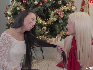 Lesbians kiss and make out by the Christmas Tree